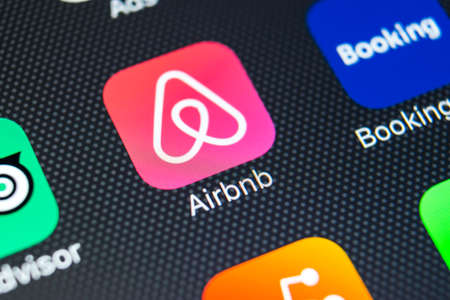 Sankt-Petersburg, Russia, February 9, 2018: Airbnb application icon on Apple iPhone X screen close-up. Airbnb app icon. Airbnb.com is online website for booking rooms. social media network. Editoriali