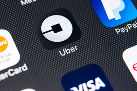 Sankt-Petersburg, Russia, February 9, 2018: Uber application icon on Apple iPhone X screen close-up. Uber app icon. Uber is taxi car transportation application.