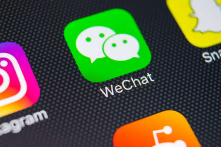 Sankt-Petersburg, Russia, February 9, 2018: Wechat messenger application icon on Apple iPhone 8 smartphone screen close-up. Wechat messenger app icon. Social media network.
