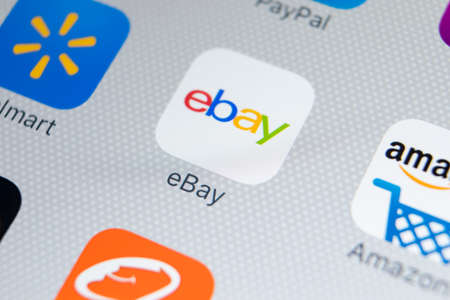 Sankt-Petersburg, Russia, February 9, 2018: eBay application icon on Apple iPhone X screen close-up. eBay app icon. eBay.com is largest online auction and shopping websites. Éditoriale