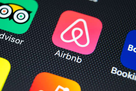 Sankt-Petersburg, Russia, February 9, 2018: Airbnb application icon on Apple iPhone X screen close-up. Airbnb app icon. Airbnb.com is online website for booking rooms. social media network. 新闻类图片