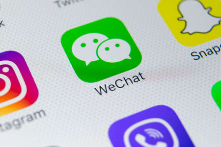 Sankt-Petersburg, Russia, February 9, 2018: Wechat messenger application icon on Apple iPhone X smartphone screen close-up. Wechat messenger app icon. Social media network.