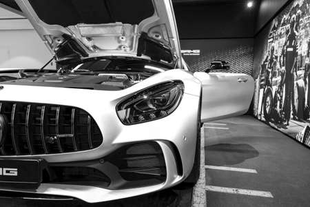 Sankt-Petersburg, Russia, January 12, 2018 : Mercedes-Benz AMG GTR 2018 V8 Bi-turbo exterior details, Headlight. Front view. Car exterior details. Black and white 에디토리얼