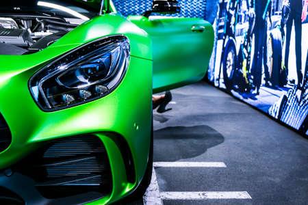 Sankt-Petersburg, Russia, January 12, 2018 : Green Mercedes-Benz AMG GTR 2018 V8 Biturbo exterior details, Headlight. Front view. Car exterior details