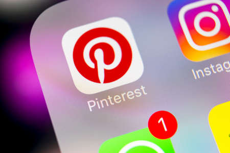 Sankt-Petersburg, Russia, March 6, 2018: Pinterest application icon on Apple iPhone 8 smartphone screen close-up. Pinterest app icon. Pinterest is the  popular Internet social network. Social media icon Editorial
