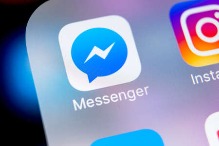 Sankt-Petersburg, Russia, March 7, 2018: Facebook messenger application icon on Apple iPhone X screen close-up. Facebook messenger app icon. Online internet social media network. Social media app Editorial