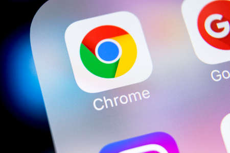 Sankt-Petersburg, Russia, March 7, 2018: Google Chrome application icon on Apple iPhone X screen close-up. Google Chrome app icon. Google Chrome application. Social media network Zdjęcie Seryjne - 97176360