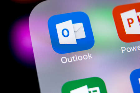 Sankt-Petersburg, Russia, March 7, 2018: Microsoft Outlook office application icon on Apple iPhone X screen close-up. Microsoft outlook app icon. Microsoft OutLook application. Social media network