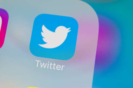 Sankt-Petersburg, Russia, March 13, 2018: Twitter application icon on Apple iPhone X smartphone screen close-up. Twitter app icon. Social media icon. Social network