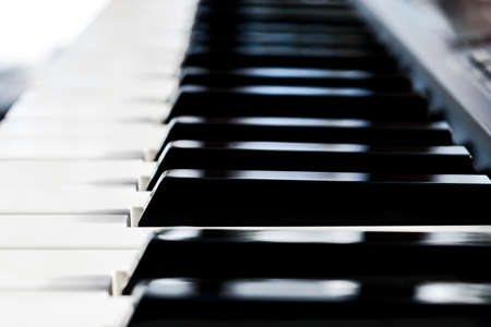 Side view of piano keys. Close-up of piano keys. Close frontal view. Piano keyboard with selective focus. Diagonal view. Piano keyboard perspective Stock Photo