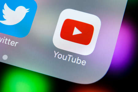 Sankt-Petersburg, Russia, March 21, 2018: YouTube application icon on Apple iPhone X smartphone screen close-up. Youtube app icon. Social media icon. Social network Editorial