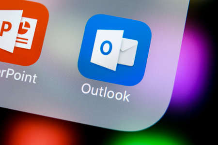 Sankt-Petersburg, Russia, March 21, 2018: Microsoft Outlook office application icon on Apple iPhone X screen close-up. Microsoft outlook app icon. Microsoft OutLook application. Social media network