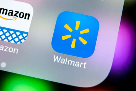 Sankt-Petersburg, Russia, March 21, 2018: Walmart application icon on Apple iPhone X screen close-up. Walmart app icon. Walmart.com is multinational retailing corporation
