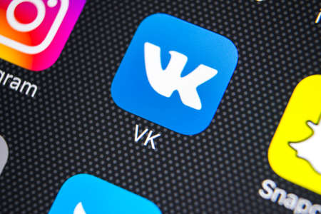 Sankt-Petersburg, Russia, March 24, 2018: Vkontakte application icon on Apple iPhone X screen close-up. VK app icon. Vkontakte mobile application. Social media network. Social media icon Editorial