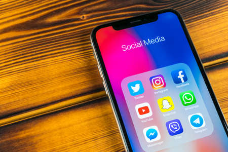Sankt-Petersburg, Russia, April 5, 2018: Apple iPhone X with icons of social media facebook, instagram, twitter, snapchat application on screen. Social media icons. Social network. Social media