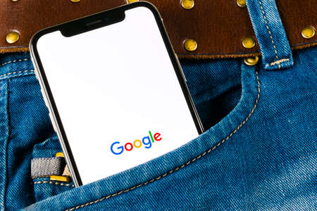 Sankt-Petersburg, Russia, April 14, 2018: Google application icon on Apple iPhone X smartphone screen close-up in jeans pocket. Google app icon. Social network. Social media icon
