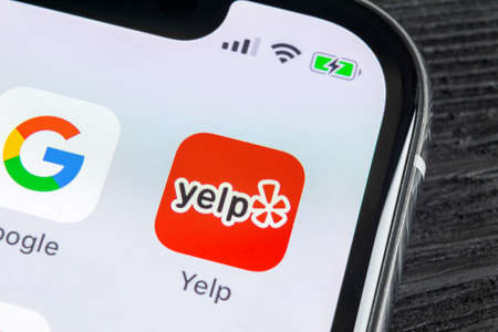 Sankt-Petersburg, Russia, April 27, 2018: Yelp application icon on Apple iPhone X screen close-up. Yelp app icon. Yelp.com application. Social network. Social media