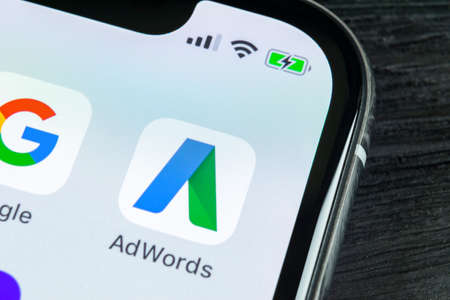 Sankt-Petersburg, Russia, April 27, 2018: Google AdWords application icon on Apple iPhone X screen close-up. Google Ad Words icon. Google Adwords application. Social media network Editorial