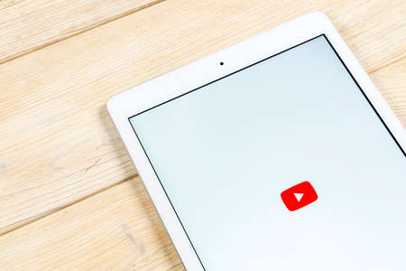 Sankt-Petersburg, Russia, April 2, 2018: YouTube application icon on Apple iPad smartphone screen close-up. Youtube app icon. Social media icon. Social network