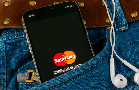 Sankt-Petersburg, Russia, April 14, 2018: MasterCard application icon on Apple iPhone X screen close-up in jeans pocket. Master Card icon. MasterCard online application. Social media app