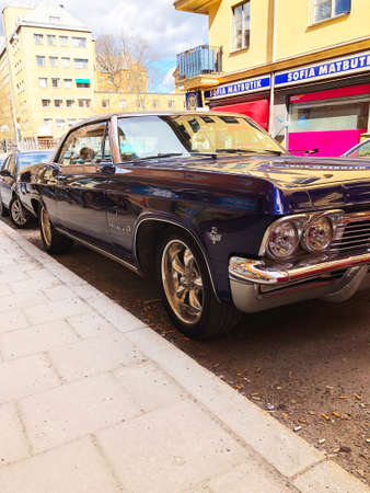 Stockholm, Sweden, April 21 2018: Front view of old retro classic car Chevrolet Impala SS 1965 on city street. Car detailing