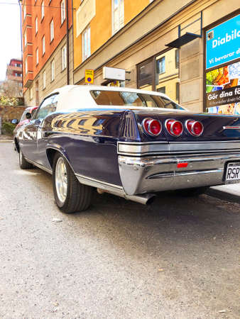 Stockholm, Sweden, April 24 2018: Back view of old retro classic car Chevrolet Impala SS 1965 on city street. Car detailing