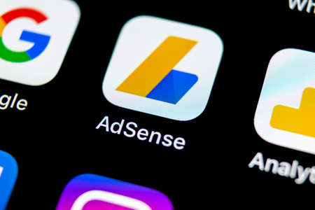 Sankt-Petersburg, Russia, May 10, 2018: Google AdSense application icon on Apple iPhone X screen close-up. Google AdSense app icon. Google AdSense application. Social media network Editorial