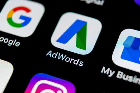 Sankt-Petersburg, Russia, May 10, 2018: Google AdWords application icon on Apple iPhone X screen close-up. Google Ad Words icon. Google Adwords application. Social media network