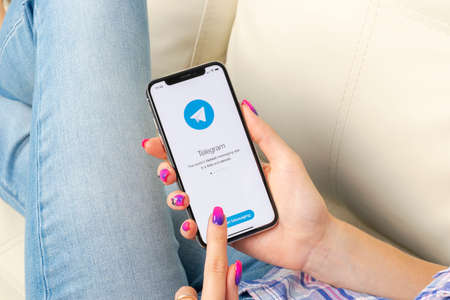 Sankt-Petersburg, Russia, May 30, 2018: Telegram application icon on Apple iPhone X screen close-up in woman hands. Telegram app icon. Telegram is an online social media network. Social media app Editorial