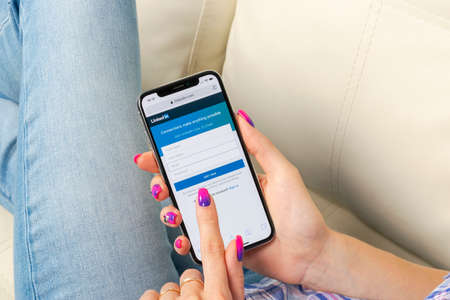 Sankt-Petersburg, Russia, May 30, 2018: Linkedin homepage on Apple iPhone X screen close-up in woman hands. Linkedin app icon. linkedin.com.  Social media app. Social network