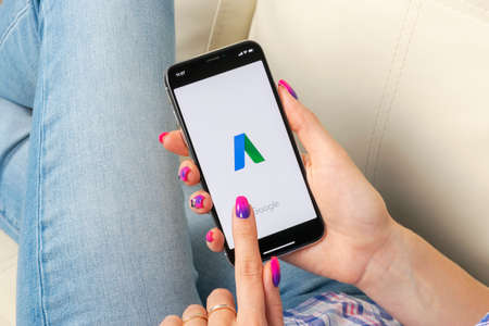 Sankt-Petersburg, Russia, May 30, 2018: Google AdWords application icon on Apple iPhone X screen in woman hands. Google Ad Words Express icon. Google Adwords application. Social media network