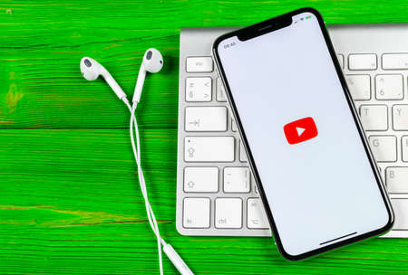 Sankt-Petersburg, Russia, June 2, 2018: YouTube application icon on Apple iPhone X smartphone screen close-up. Youtube app icon. Social media icon. Social network