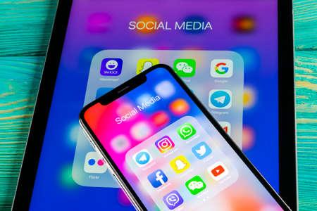 Sankt-Petersburg, Russia June 8, 2018: Apple iPhone X and iPad with icons of social media facebook, instagram, twitter, snapchat application on screen. Social media icons. Social network. Social media Editorial