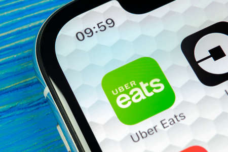 Sankt-Petersburg, Russia, June 20, 2018: Uber Eats application icon on Apple iPhone X smartphone screen close-up. Uber eats app icon. Social network. Social media icon