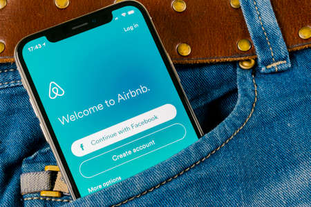 Sankt-Petersburg, Russia, April 14, 2018: Airbnb application icon on Apple iPhone X screen close-up in jeans pocket. Airbnb app icon. Airbnb.com is online website for booking rooms. social media network.