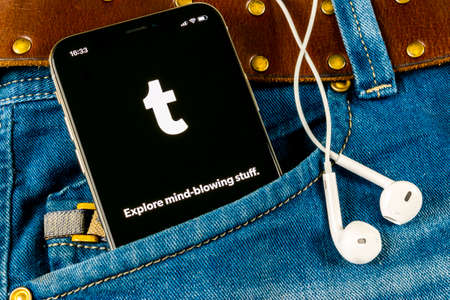 Sankt-Petersburg, Russia, April 14, 2018: Tumblr plus application icon on Apple iPhone X smartphone screen close-up in jeans pocket. Tumblr plus app icon. Tumblr is internet online social network Editorial