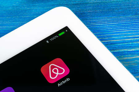 Sankt-Petersburg, Russia, July 6, 2018: Airbnb application icon on Apple iPad Pro screen close-up. Airbnb app icon. Airbnb.com is online website for booking rooms. social media network. Editoriali