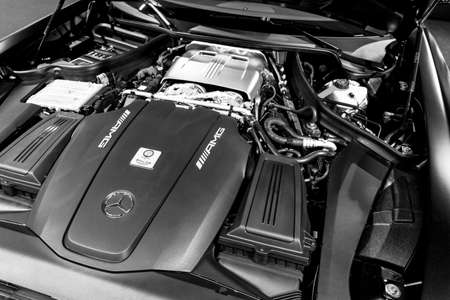 Sankt-Petersburg, Russia, January 12, 2018 : Close up of Mercedes-Benz engine AMG GTR 2018 V8 Bi-turbo exterior details. Powerful handcrafted engine. Black and white