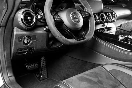Sankt-Petersburg, Russia, January 12, 2018 : Mercedes-Benz AMG GTR 2018 V8 Bi-turbo. Black perforated leather interior. Dashboard and steering whell. Car interior details. Black and white Editorial