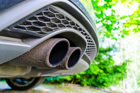 Close up of a car dual exhaust pipe. Double exhaust pipes of a modern sports car. Car exterior details. Car detailing
