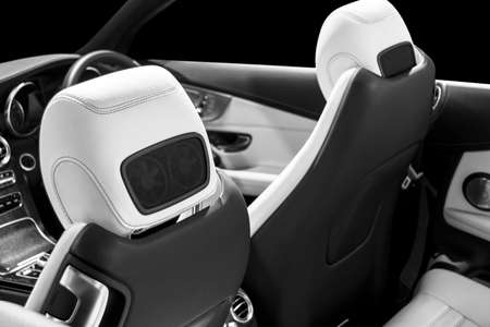Modern Luxury car inside. Interior of prestige modern car. Comfortable leather seats. Perforated leather with isolated Black background. Modern car interior. Car detailing. Black and white