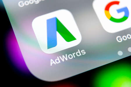 Sankt-Petersburg, Russia, August 10, 2018: Google AdWords application icon on Apple iPhone X screen close-up. Google Ad Words icon. Google Adwords application. Social media network