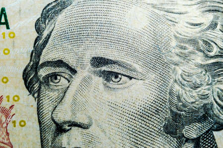 Close up view Portrait of Alexander Hamilton on the one ten dollar bill. Background of the money. 10 dollar bill with Alexander Hamilton eyes macro shot. Money background. Face portrait 에디토리얼