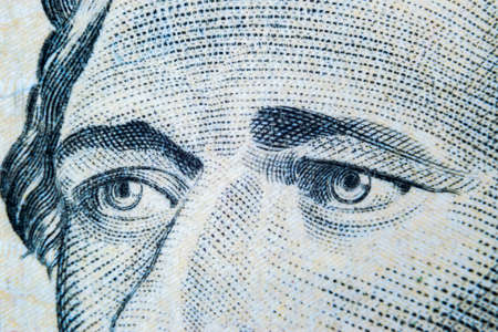 Close up view Portrait of Alexander Hamilton on the one ten dollar bill. Background of the money. 10 dollar bill with Alexander Hamilton eyes macro shot. Money background. Face portrait 報道画像