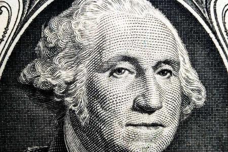 US president George Washington face portrait on the USA one dollar note. Macro shot. Background of the money. George Washington eyes macro shot. 報道画像