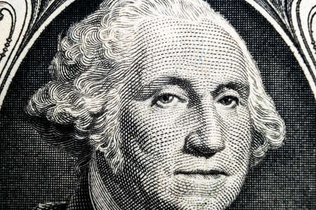 US president George Washington face portrait on the USA one dollar note. Macro shot. Background of the money. George Washington eyes macro shot. Editöryel