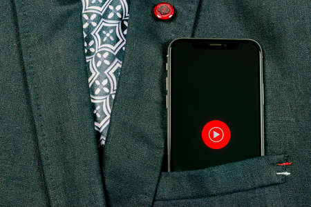 Sankt-Petersburg, Russia, August 24, 2018: YouTube Music application icon on Apple iPhone X smartphone screen close-up in jacket pocket. Youtube music app icon. Social media icon. Social network