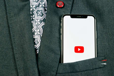 Sankt-Petersburg, Russia, August 24, 2018: YouTube application icon on Apple iPhone X smartphone screen close-up in jacket, pocket. Youtube app icon. Social media icon. Social network Editorial
