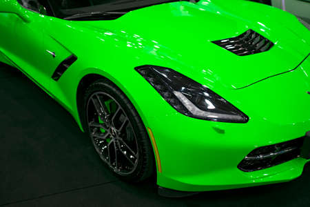Sankt-Petersburg, Russia, July 21, 2017: Front view of a green Chevrolet Corvette Z06. Car exterior details.