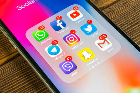 Sankt-Petersburg, Russia, September 2, 2018: Apple iPhone X with icons of social media facebook, instagram, twitter, snapchat, google application on screen. Social media icons. Social network Editorial